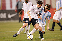 United States defender Heath Pearce (15) and Argentina midfielder Fernando Gago (5). The men's national teams of the United States and Argentina played to a 0-0 tie during an international friendly at Giants Stadium in East Rutherford, NJ, on June 8, 2008.
