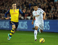Sunday 09 November 2014 <br /> Pictured L-R: Calum Chambers of Arsenal against Jefferson Montero of Swansea<br /> Re: Barclays Premier League, Swansea City FC v Arsenal City at the Liberty Stadium, Swansea, Great Britain.