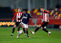9th January 2021; Brentford Community Stadium, London, England; English FA Cup Football, Brentford FC versus Middlesbrough; Marcus Forss of Brentford challenges Sam Folarin of Middlesbrough