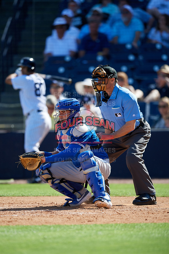 Toronto Blue Jays catcher Reese McGuire (10) and home plate umpire Dan Iassogna during a Grapefruit League Spring Training game against the New York Yankees on February 25, 2019 at George M. Steinbrenner Field in Tampa, Florida.  Yankees defeated the Blue Jays 3-0.  (Mike Janes/Four Seam Images)