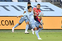 KANSAS CITY, KS - SEPTEMBER 02: Felipe Hernandez #21 of Sporting Kansas City fights for the ball with  Bryan Acosta #8 of FC Dallas during a game between FC Dallas and Sporting Kansas City at Children's Mercy Park on September 02, 2020 in Kansas City, Kansas.