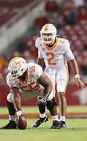 Tennessee quarterback Jarrett Guarantano (2) takes a snap, Saturday, November 7, 2020 during the first quarter of a football game at Donald W. Reynolds Razorback Stadium in Fayetteville. Check out nwaonline.com/201108Daily/ for today's photo gallery. <br /> (NWA Democrat-Gazette/Charlie Kaijo)