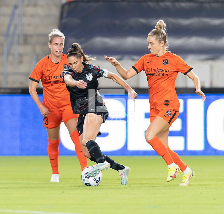 HOUSTON, TX - SEPTEMBER 10: Morgan Gautrat #13 of the Chicago Red Stars dribbles the ball away from Sophie Schmidt #13 and Kristie Mewis #19 of the Houston Dash during a game between Chicago Red Stars and Houston Dash at BBVA Stadium on September 10, 2021 in Houston, Texas.