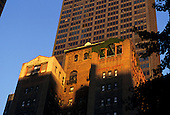 New York, USA. Red brick building with green creeper growing over top section in golden late evening sunlight.