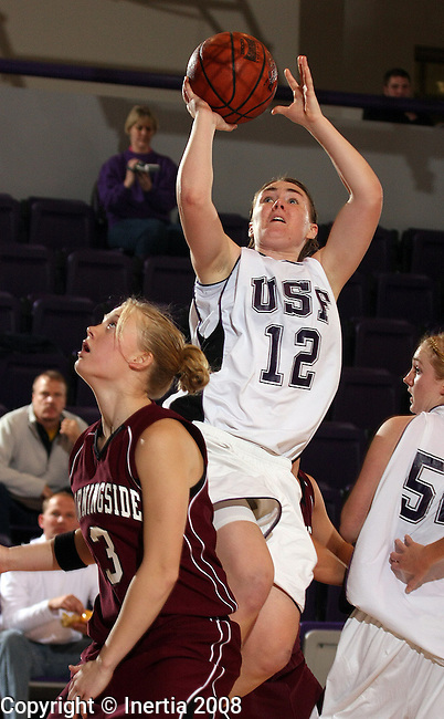 SIOUX FALLS, SD - January 13:  Becky Christofferson #12 of the University of Sioux Falls looks for a jumper over Dani Gass #3 of Morningside in the second half of their game Wednesday night at the Stewart Center. (Photo by Dave Eggen/Inertia)