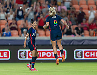 HOUSTON, TX - JUNE 13: Lindsey Horan #9 of the USWNT celebrates with Christen Press #23 during a game between Jamaica and USWNT at BBVA Stadium on June 13, 2021 in Houston, Texas.