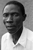 """Portrait of a man HIV positive. This man attends a support group in the town of Bugembe. The group has been formed by people that are sick with the disease and is called """"Living with HIV."""" The name is to stress, not the fact that the individuals are infected, but how to now live their lives in a positive manner.  Uganda has an estimated 1.5 million people infected with HIV/AIDS.  Bugembe, Jinja District, Uganda, Africa. June 2004 © Stephen Blake Farrington"""