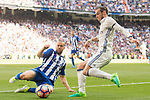 Gareth Bale (r) of Real Madrid battles for the ball with Victor Laguardia Cisneros of Deportivo Alaves during their La Liga match between Real Madrid and Deportivo Alaves at the Santiago Bernabeu Stadium on 02 April 2017 in Madrid, Spain. Photo by Diego Gonzalez Souto / Power Sport Images