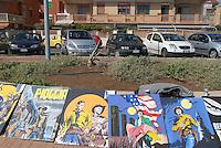 - Lido di Ostia, exhibition of paintings on seafront sidewalk....- Lido di Ostia, mostra di quadri sul marciapiede del lungomare