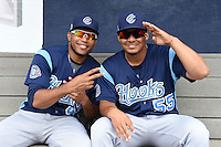 Corpus Christi Hooks pitchers Jorge De Leon (43) and Luis Cruz (55) in the dugout before a game against the NW Arkansas Naturals on May 26, 2014 at Arvest Ballpark in Springdale, Arkansas.  NW Arkansas defeated Corpus Christi 5-3.  (Mike Janes/Four Seam Images)