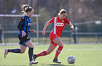 Charlotte Cranshoff (18) of Standard  pictured with Celien Guns (10) of Club Brugge during a female soccer game between Club Brugge Dames YLA and Standard Femina de Liege on the 17 th matchday of the 2020 - 2021 season of Belgian Scooore Womens Super League , saturday 20 March 2021  in Brugge , Belgium . PHOTO SPORTPIX.BE   SPP   DAVID CATRY
