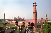 Boys fly kites in front of Lahore's Badshahi Mosque. It was built in 1674 on The Grand Trunk Road, opposite the Lahore Fort which housed the palaces of the Moghul emperors. The courtyard can hold up to 60,000 worshippers.