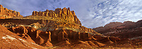 908000004 panoramic view sunrise lights up the brilliant red and gold sandstone formations of the castle in capitol reef national park utah