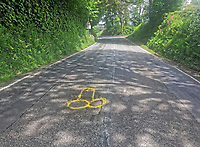 "Pictured: The phallic shaped yellow graffiti highlighting a pothole near Crundale, west Wales, UK.<br /> Re: Pembrokeshire hyas been struck by a notorious mystery graffiti artist known for using obscene images to highlight the blight of potholes.<br /> A bright yellow spray painted penis has been spotted scrawled over a pothole near Crundale, west Wales.<br /> The piece of graffiti was potentially inspired by a protest artist known as Wanksy, who began spray painting penises onto potholes around Greater Manchester in 2015 and gained a viral following.<br /> This treatment has since become the hallmark of a UK-wide phenomenon where residents take pothole management into their own hands. <br /> Wanksies have arisen to protest potholes in Cambridgeshire and Essex in the last few years, among other places.<br /> A motorist who did not wish to be named spotted the piece of graffiti.<br /> ""I was shocked and appalled when I saw it, that sort of thing really rubs me up the wrong way,"" said the motorist.<br /> ""I was just driving home for lunch. I had to pull off the road when I noticed it,"" they added.<br /> ""Obviously potholes are a pain, but is this the way to highlight them? I don't think so: someone needs a stiff talking to!"""