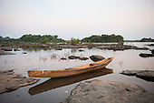Xingu River, Para State, Brazil. The Volta Grande; Aldeia Terra Wangã da Volta Grande - Maia, Arara ethnic group. New traditional carved wooden canoe.