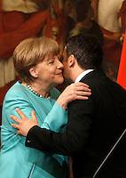 Il cancelliere tedesco Angela Merkel, sinistra, bacia il presidente del Consiglio Matteo Renzi a Palazzo Chigi, Roma, 5 maggio 2016.<br /> German Chancellor Angela Merkel, left, kisses Italian Premier Matteo Renzi at the end of their meeting at Chigi Palace, Rome, 5 May 2016.<br /> UPDATE IMAGES PRESS/Isabella Bonotto
