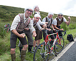"Grand Depart - Tour de France 2014<br /> Yorkshire England.<br /> Second stage passes through ""Blubberhouses Moor""<br /> on the road from Harrogate<br /> Cycling fans dressed as Monty Python  ""Gumby"" Gumbys<br /> characters.<br /> from the famous sketch<br /> Merrell Brothers - Andy, Martin, Gary, Simon - with their friend also Martin.<br /> <br /> <br /> <br /> Pic by Gavin Rodgers/Pixel 8000 Ltd"