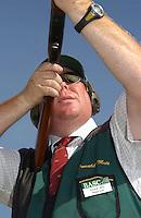Shotgun coach Donald Muir.