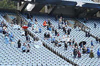 CHAPEL HILL, NC - OCTOBER 10: Socially distanced fans stand for the national anthem before a game between Virginia Tech and North Carolina at Kenan Memorial Stadium on October 10, 2020 in Chapel Hill, North Carolina.