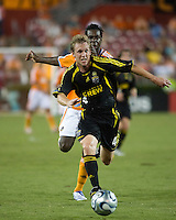 Houston Dynamo forward Joseph Ngwenya (33) chases after Columbus Crew defender Rusty Pierce (4). The Houston Dynamo tied the Columbus Crew 1-1 in a regular season MLS match at Robertson Stadium in Houston, TX on August 25, 2007.