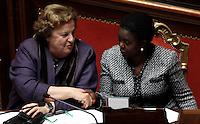 Il Ministro della Giustizia Anna Maria Cancellieri stringe la mano al Ministro per l'Integrazione Cecile Kyenge, destra, al Senato, in occasione del voto di fiducia, a Roma, 11 dicembre 2013.<br /> Italian Justice Minister Anna Maria Cancellieri shakes hands with Integration Minister Cecile Kyenge, right, at the Senate, on the occasion of a confidence vote, in Rome, 11 December 2013.<br /> UPDATE IMAGES PRESS/Isabella Bonotto