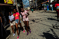 Afro-Colombian girls walk on the street during the San Pacho festival in Quibdó, Colombia, 1 October 2019. Every year at the turn of September and October, the capital of the Pacific region of Chocó holds the celebrations in honor of Saint Francis of Assisi (locally named as San Pacho), recognized as Intangible Cultural Heritage by UNESCO. Each day carnival groups, wearing bright colorful costumes and representing each neighborhood, dance throughout the city, supported by brass bands playing live music. The festival culminates in a traditional boat ride on the Atrato River, followed by massive religious processions, which accent the pillars of Afro-Colombian's identity – the Catholic devotion grown from African roots.