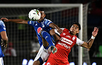 BOGOTA-COLOMBIA, 03–03-2020: Omar Bertel de Millonarios y Fabian Sambueza de Independiente Santa Fe disputan el balon, durante partido entre Millonarios y el Independiente Santa Fe de la fecha 7 por la Liga BetPlay DIMAYOR 2020 jugado en el estadio Nemesio Camacho El Campin de la ciudad de Bogota. / Omar Bertel of Millonarios and Daniel Giraldo of Independiente Santa Fe figth for the ball, during a match between Millonarios and Independiente Santa Fe of the 7th date for the BetPlay DIMAYOR Leguaje I 2020 played at the Nemesio Camacho El Campin Stadium in Bogota city. / Photo: VizzorImage / Luis Ramirez / Staff.