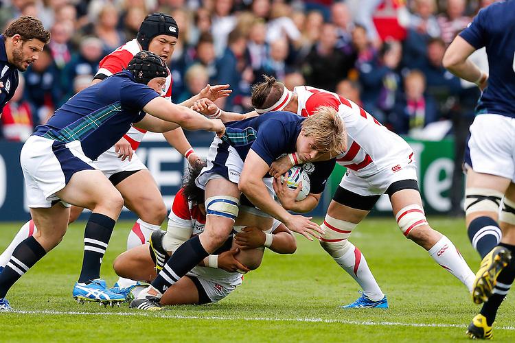 Scotland Lock Jonny Gray is tackled by Japan Lock Luke Thompson - Mandatory byline: Rogan Thomson - 23/09/2015 - RUGBY UNION - Kingsholm Stadium - Gloucester, England - Scotland v Japan - Rugby World Cup 2015 Pool B.