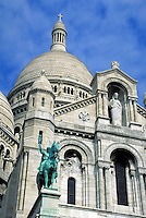 Sacre Coeur Basilica part of facade, dome and equestrian statue from southwest. Paris, France.