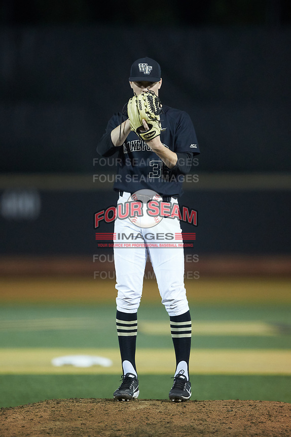 Wake Forest Demon Deacons relief pitcher William Fleming (38) looks to his catcher for the sign against the Virginia Cavaliers at David F. Couch Ballpark on May 18, 2018 in  Winston-Salem, North Carolina.  The Cavaliers defeated the Demon Deacons 15-3.  (Brian Westerholt/Four Seam Images)