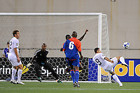 Charlie Davies (9) of the United States (USA) takes a shot. The United States and Haiti played to a 2-2 tie during a CONCACAF Gold Cup Group B group stage match at Gillette Stadium in Foxborough, MA, on July 11, 2009. .