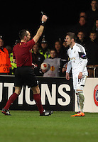 Swansea, UK. Thursday 20 February 2014<br /> Pictured L-R: Match refereeIvan Bebek shows Pablo Hernandez of Swansea a yellow card<br /> Re: UEFA Europa League, Swansea City FC v SSC Napoli at the Liberty Stadium, south Wales, UK