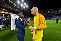 ORLANDO, FL - NOVEMBER 15: Ex US Men's national team player DaMarcus Beasley and Brad Guzan #1 chat while celebrating their victory over Canada during a game between Canada and USMNT at Exploria Stadium on November 15, 2019 in Orlando, Florida.