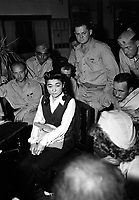 """Correspondents interview """"Tokyo Rose"""" Iva Toguri, American-born Japanese.  September 1945.  (Navy)<br /> Exact Date Shot Unknown<br /> NARA FILE #:  080-G-490488<br /> WAR & CONFLICT BOOK #:  1308"""