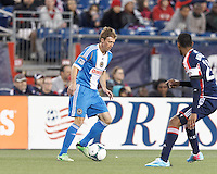 Philadelphia Union midfielder Brian Carroll (7) brings the ball forward. In a Major League Soccer (MLS) match, the New England Revolution (blue/red) defeated Philadelphia Union (blue/white), 2-0, at Gillette Stadium on April 27, 2013.