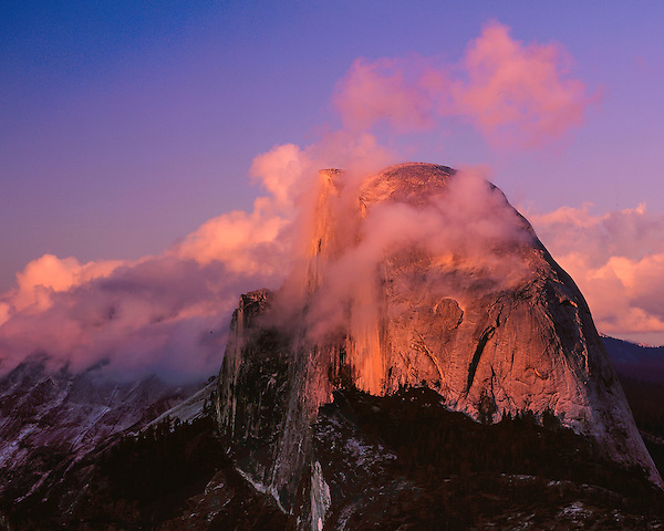Half Dome at sunset in Yosemite National Park, California .  John offers private photo tours throughout the western USA, especially Colorado. Year-round. John offers private photo tours in Yosemite National Park and throughout California and Colorado. Year-round.