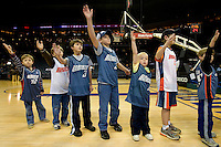 Young fans wait to shake hands with players during an NBA basketball game Time Warner Cable Arena in Charlotte, NC.