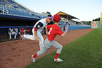 Infielder Sean Coyle (3) of the Salem Red Sox is introduced to the crowd and runs onto the field with a youth baseball player before a game against the Winston-Salem Dash on June 6, 2012, at LewisGale Field in Salem, Virginia. Salem won, 4-1. (Tom Priddy/Four Seam Images)