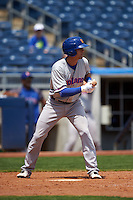 Midland RockHounds shortstop Chad Pinder (10) squares to bunt during a game against the Tulsa Drillers on June 3, 2015 at Oneok Field in Tulsa, Oklahoma.  Midland defeated Tulsa 5-3.  (Mike Janes/Four Seam Images)