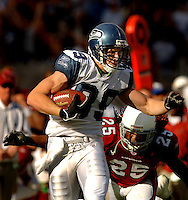 Nov. 6, 2005; Tempe, AZ, USA; Wide receiver (89) Jerheme Urban of the Seattle Seahawks runs from cornerback (25) Eric Green of the Arizona Cardinals at Sun Devil Stadium. Mandatory Credit: Mark J. Rebilas