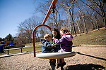 Rosaleen and her 2 kids at the local park. Juggling her family and business life has been the hardest part of the vigil..A day in the life of Rosaleen Tallon, sister of firefighter Sean Tallon killed in the 9/11 World Trade Center attacks. In response to the proposed WTC memorial being built underground at the site, Ms. Tallon has been sleeping for 16 days in front of the fire house across from the WTC site. She and several other WTC families are protesting the memorial design and asking for the victim's names to be placed above ground for the sake of honoring the lives lost and safety concerns with any possible future evacuation of the site.