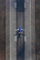 aerial photograph of an airliner on the runway Los Angeles International airport (LAX), Los Angeles, California