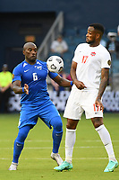 KANSASCITY, KS - JULY 11: Jean-Sylvain Babin #6 of Martinique ,Cyle Larin #17 of Canada during a game between Canada and Martinique at Children's Mercy Park on July 11, 2021 in KansasCity, Kansas.