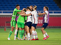 YOKOHAMA, JAPAN - JULY 30: Alyssa Naeher #1 and the USWNT celebrate advancing to the semifinals during a game between Netherlands and USWNT at International Stadium Yokohama on July 30, 2021 in Yokohama, Japan.