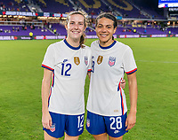 ORLANDO, FL - JANUARY 22: Tierna Davidson #12 and Alana Cook #28 of the USWNT pose for a photo after a game between Colombia and USWNT at Exploria stadium on January 22, 2021 in Orlando, Florida.