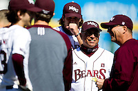 Head Coach Keith Guttin (2) of the Missouri State Bears laughs during a pregame meeting prior to a game against the Southern Illinois University- Edwardsville Cougars at  Hammons Field on March 10, 2012 in Springfield, Missouri. (David Welker / Four Seam Images)