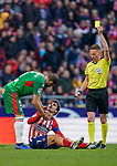 Victor Laguardia Cisneros of Deportivo Alaves talks to Antoine Griezmann of Atletico de Madrid as referee Alejandro Jose Hernandez Hernandez shows Deportivo Alaves player the yellow card during the La Liga 2018-19 match between Atletico de Madrid and Deportivo Alaves at Wanda Metropolitano on December 08 2018 in Madrid, Spain. Photo by Diego Souto / Power Sport Images