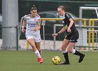 Zenia Mertens (6) of OH Leuven and Loes Van Mullem (33) of Eendracht Aalst pictured during a female soccer game between Oud Heverlee Leuven and Eendracht Aalst on the second matchday of the 2021 - 2022 season of Belgian Womens Super League , sunday 29 nd of August 2021  in Heverlee , Belgium . PHOTO SPORTPIX.BE   JILL DELSAUX