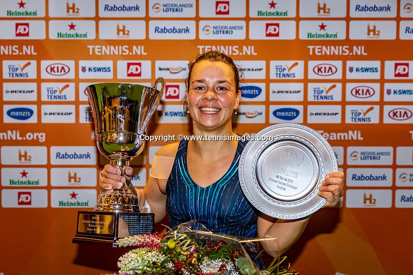 Alphen aan den Rijn, Netherlands, December 22, 2019, TV Nieuwe Sloot,  NK Tennis, Final womens wheelchair,  Marjolein Buis (NED) with the winners trophy<br /> Photo: www.tennisimages.com/Henk Koster