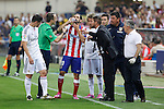 Atletico de Madrid´s Juanfran and coach Diego Pablo `Cholo´Simeone argue with the referee and Real Madrid´s Fabio Coentrao and James Rodriguez during 2014 Supercopa de España `Spain Supercup´ second leg match at Vicente Calderon stadium. August 22, 2014. (ALTERPHOTOS/Victor Blanco)